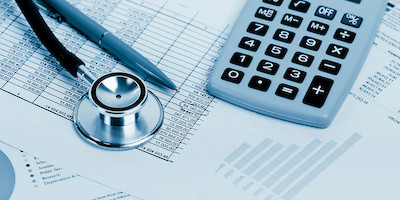 Chart of Medical Expenses with Stethoscope and Calculator