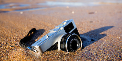 Camera Half Buried By Sand at Low Tide
