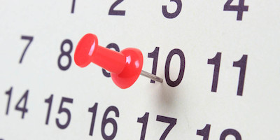 A Pushpin on the 10th Day of a Month on a Calendar
