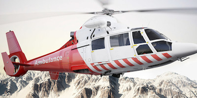 Ambulance Helocopter Taking Off in Mountains