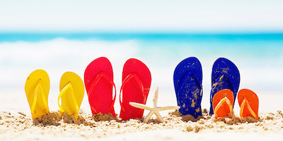Colorful Family of FlipFlops with Starfish on Beach