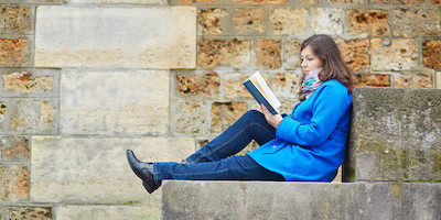 Young Woman Reading on Steps