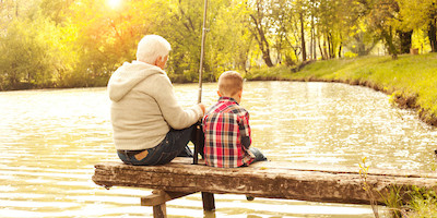 Grandfather and Grandson Fishing in small Pond