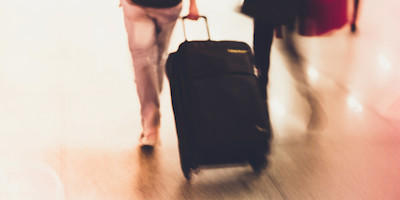 People walking with luggage