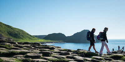 Couple Hiking Along Coast of Ireland