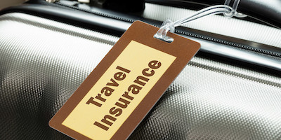 Travel Insurance Tag on Luggage