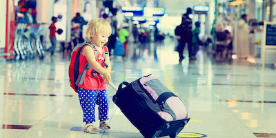 Toddler Pulling Baggage in Airport Terminal