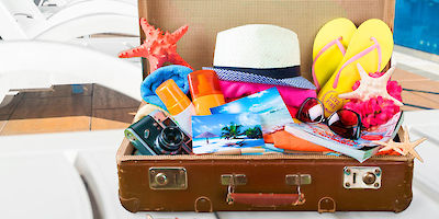 Suitcase Stuffed with Vacation Gear