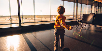 Little Boy Playing in Airport