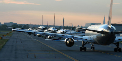 Long Line of Planes Waiting to Take Off on Tarmac
