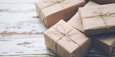 Brown Paper Packages Wrapped with a Bow